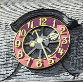 picture of bonnes  - old exterior clock at a house in Bonn - JPG