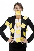 Business woman with yellow paper notes all over the body, isolated over a white background