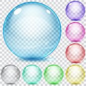 image of orbs  - Set of multicolored transparent glass spheres on a plaid background - JPG