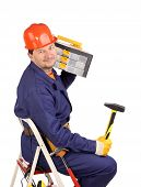 Worker On Ladder With Hammer And Toolbox.