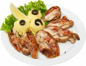 Oven baked rabbit meal with potato garnish, olives and salad
