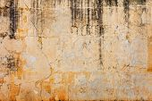 Old Concrete Wall With Peels Off Paint