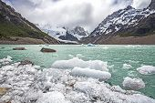 stock photo of natal  - Winter in Los Glaciares National Park Cerro Torre mountain in clouds Patagonia Argentina South America - JPG