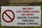 stock photo of no entry  - Red UK Army warning sing Military Firing Range No Entry Unless Cleared Through Range Control - JPG