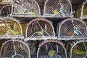 picture of lobster trap  - Stacks of wooden lobster traps in North Rustico - JPG