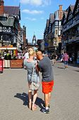 Couple using mobile phone, Chester.