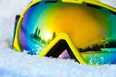 Close up view of ski mask on snow with snowflakes
