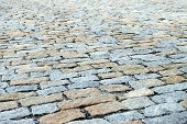 pic of pavestone  - Bridge, covered with paving stones, disappearing into the distance