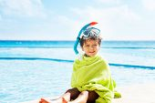 Small boy with towel on him and snorkel mask