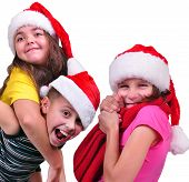 Group Of Happy Children With Santa Claus Red Hats