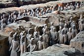 picture of qin dynasty  - Terracotta warriors in formation displayed in a burial pit at the Terracotta Army Museum in Xian China - JPG