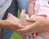 Hands Holding Small Baby Feet