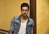 Attractive Young Man Indoors, Leaning Against Door Jamb