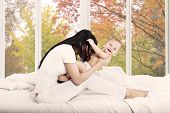 Cheerful Baby And Her Mother On Bedroom
