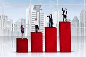 Entrepreneurs Standing Over Business Graph