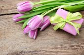 Tulips With A Gift Box On Old Wooden