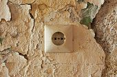 Old Electrical Outlet On Decrepit Wall