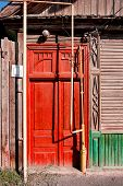 Bright red door of the slum house in Astrakhan, Russia
