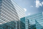 Modern Glass Skyscraper Under The Blue Sky