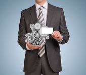 Businessman hold empty card and clockwork