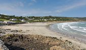 foto of west village  - Coverack beach Cornwall England UK with white waves coastal fishing village on the Lizard Heritage coast South West England on a sunny summer day - JPG