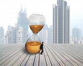 Businessman Hold The Inclined Hourglass