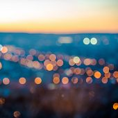 City Blurring Lights Abstract Circular Bokeh On Blue Background With Horizon, Closeup
