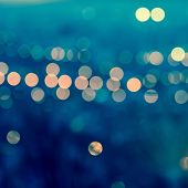 City Blurring Lights Abstract Circular Bokeh On Toned Blue Background , Closeup , Retro Style