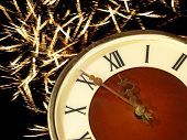 Eve Of New Year.clock Face And Golden Firework.