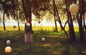 Woman With Balloons Around Her