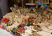 Wooden trinkets in a market booth