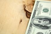 American 100 U.s. Dollars On Wooden Background