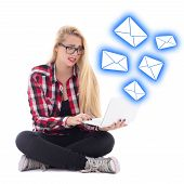 Spam Concept - Young Beautiful Astonished Blondie Woman Sitting With Laptop Isolated On White