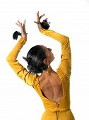 foto of castanets  - young Spanish woman dancing Sevillanas with castanets in hands wearing yellow dress with open back in flamenco traditional dance of Spain concept isolated on white background - JPG