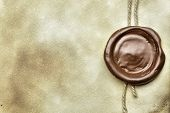 stock photo of wax seal  - Old paper with wax seal close up - JPG