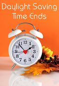 Daylight Savings Time Ends In Autumn Fall With Clock Concept And Text Message On Orange Background.