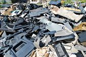 pic of scrap-iron  - Old parts scrapped cars in a junk yard - JPG