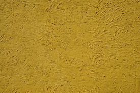 image of errat  - The texture of mustard color walls painted large erratic strokes of pain - JPG