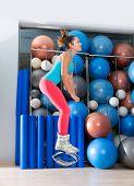 Kangaroo jumps anti gravity fitness boots girl at gym indoor