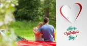 Loving couple admiring nature while leaning on their cabriolet against cute valentines message