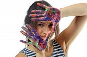 Girl Covers Her Face With Her Hands Painted In Colorful Paint