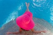 young beautiful woman relaxing in pool, summer vacations in tropics
