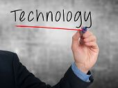 Businessman hand writing technology in the air - Stock image