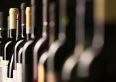 picture of wine cellar  - Row of vintage wine bottles in a wine cellar  - JPG