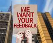 We Want Your Feedback card with a urban background