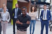 young multiethnic business people group walking standing and top view
