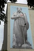 PRAGUE, CZECH REPUBLIC - JUNE 13, 2014: Huge banner depicted Russian president Vladimir Putin dressed as Josef Stalin and with Adolf Hitler moustache on the DOX Centre in Prague, Czech Republic.