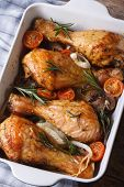 Chicken Legs With Mushrooms In A Baking Dish Vertical Top View