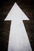 A White Traffic Arrow Signage