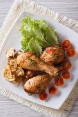 Fried Chicken Legs With Mushrooms And Tomatoes Vertical Top View